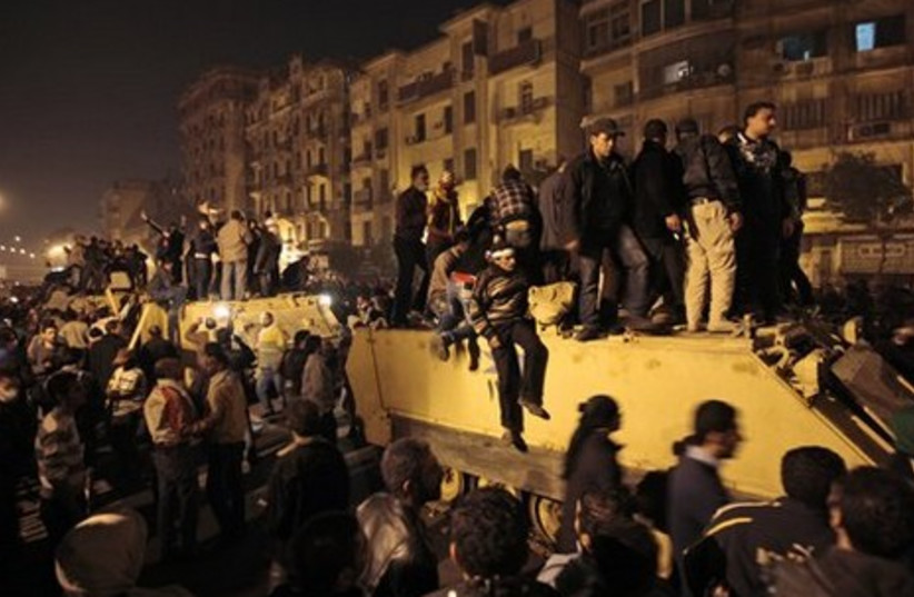 Egypt protesters on a military APC
