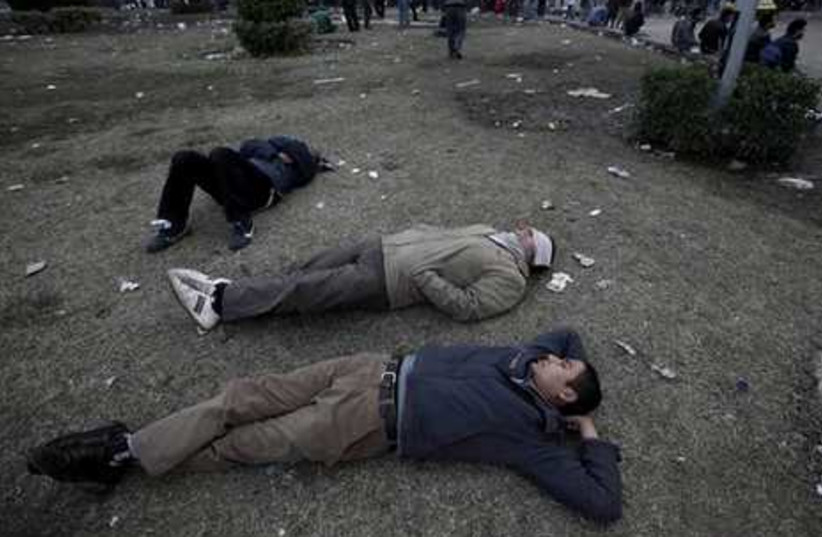 Anti-government protesters sleep on the ground