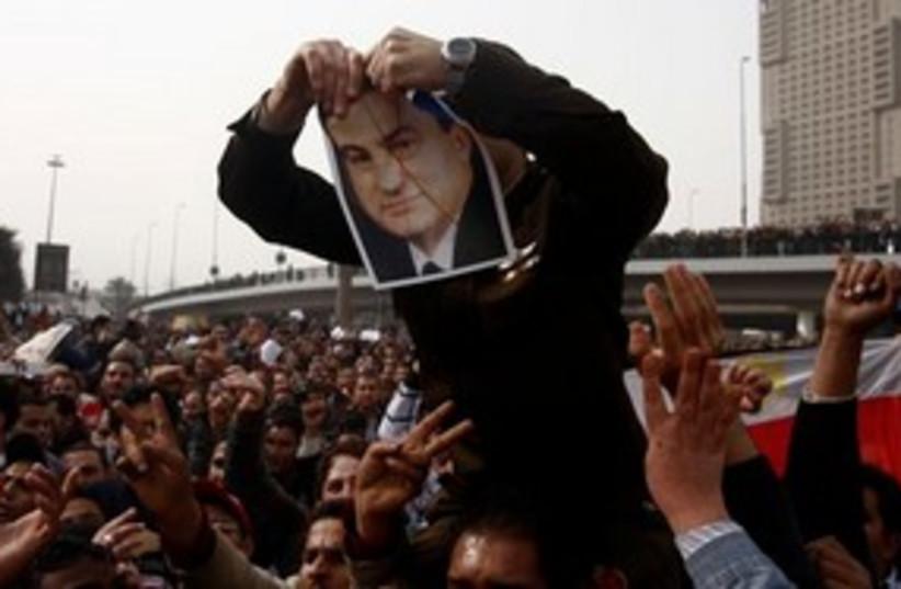 Mubarak picture ripped 311 (photo credit: Associated Press)