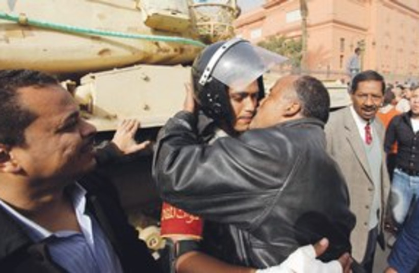 egyptian protestor kissing army officer_311 (photo credit: ASSOCIATED PRESS)