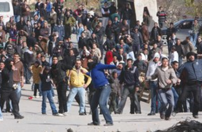 palestinians throw stones in Beit Omar_311 (photo credit: ASSOCIATED PRESS)