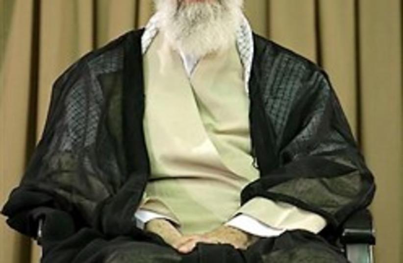 Iranian supreme leader Ayatollah Ali Khamenei sits (photo credit: AP)