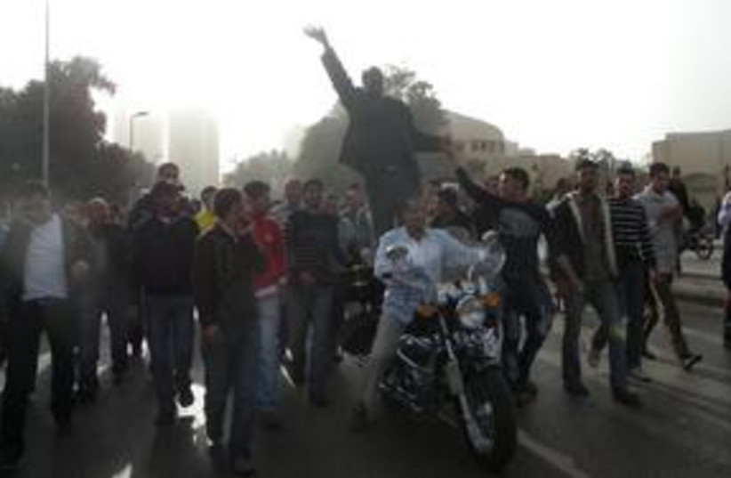 Egyptian protesters on mortcycle 311 (photo credit: MELANIE LIDMAN)