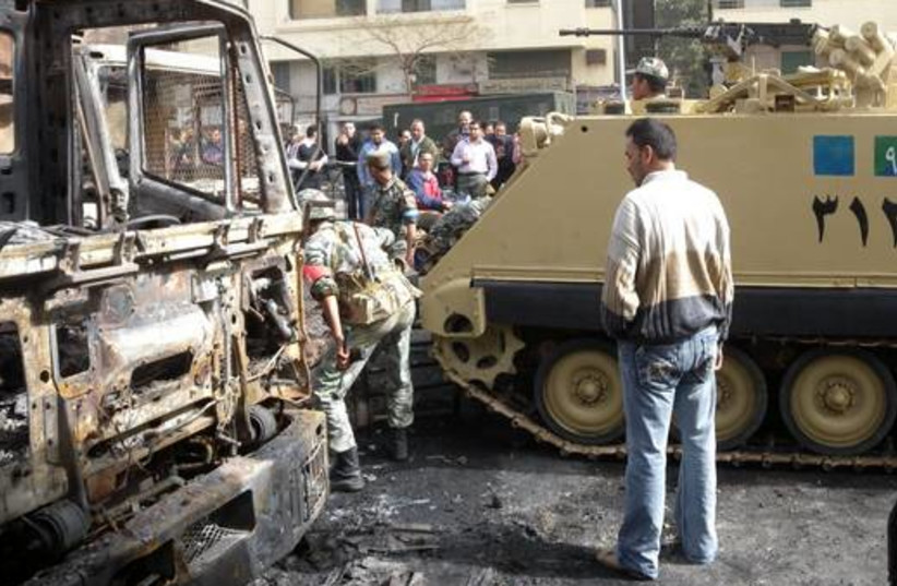 Egyptian soldiers patrol streets  in Cairo