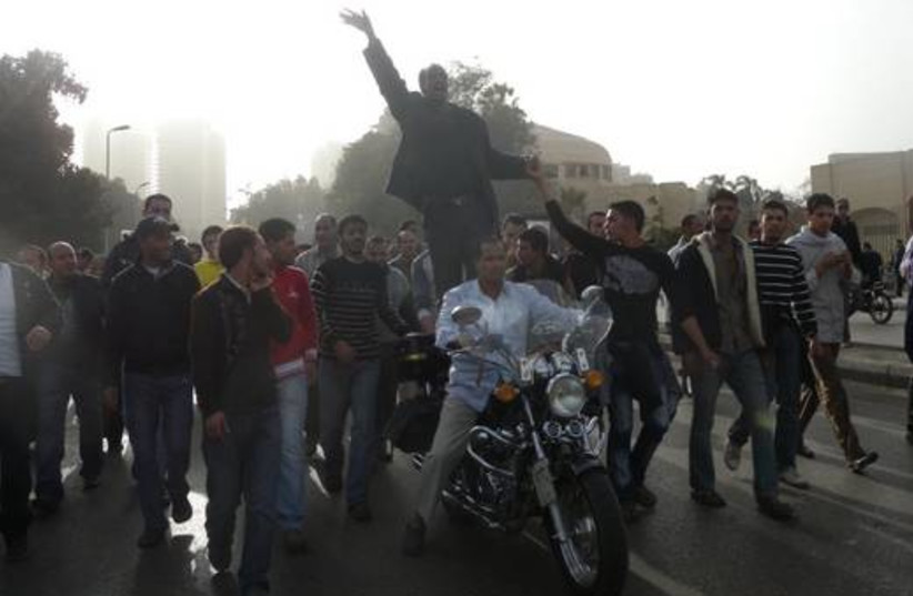 Egyptian protesters on a motorcycle