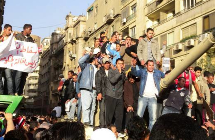 Egyptian protesters on tank