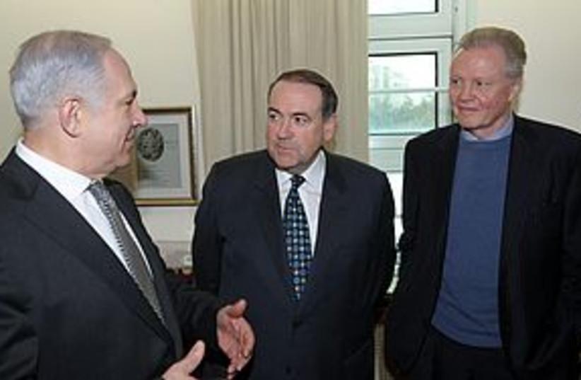 netanyahu huckabee voight 311 (photo credit: GPO / Amos Ben-Gershom)