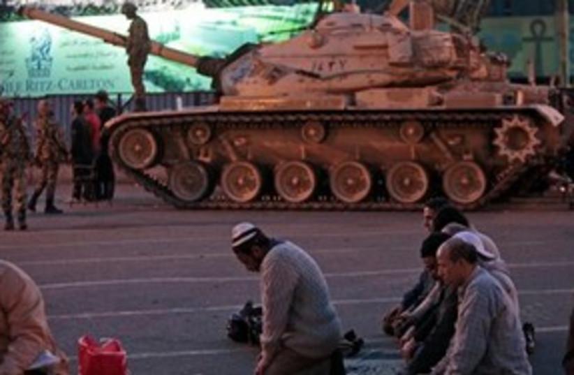 Egpyt tank pray protest Cairo Tahrir 311 AP (photo credit: AP)