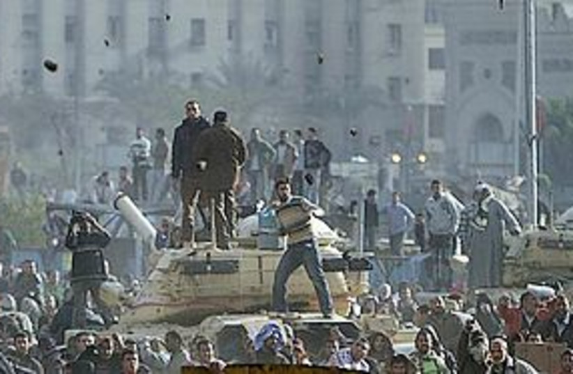 egypt protest rock throwing 311 (photo credit: AP)