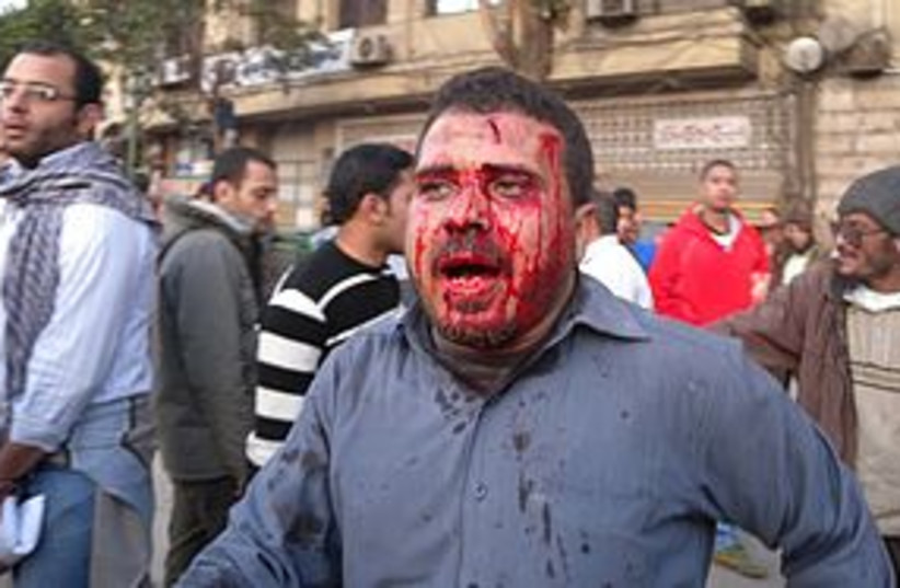 bloody egypt protester 311 (photo credit: MELANIE LIDMAN)