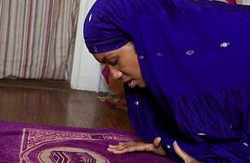 muslim woman prayer hijab 311 (photo credit: Associated Press)