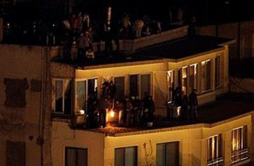 egypt protest rooftop night firebomb 311 (photo credit: AP)