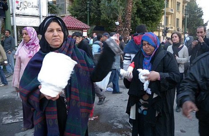 Egyptian women bring bandages to protesters