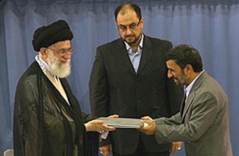 Mahmoud Ahmadinejad receives the presidential decr (photo credit: AP)