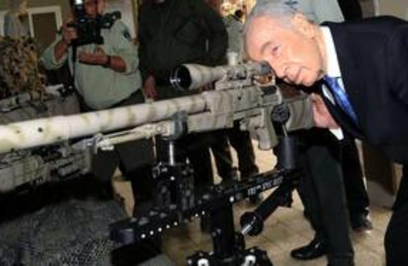 Peres with big gun 311 (photo credit: Courtesy)