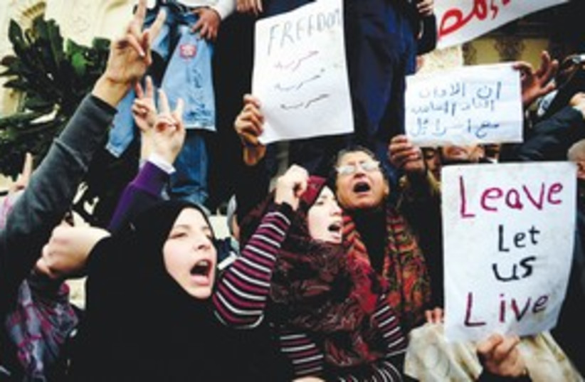 Cairo protesters freedom signs 311 AP (photo credit: AP)