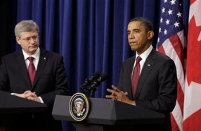Obama with Harper 311 (photo credit: Associated Press)