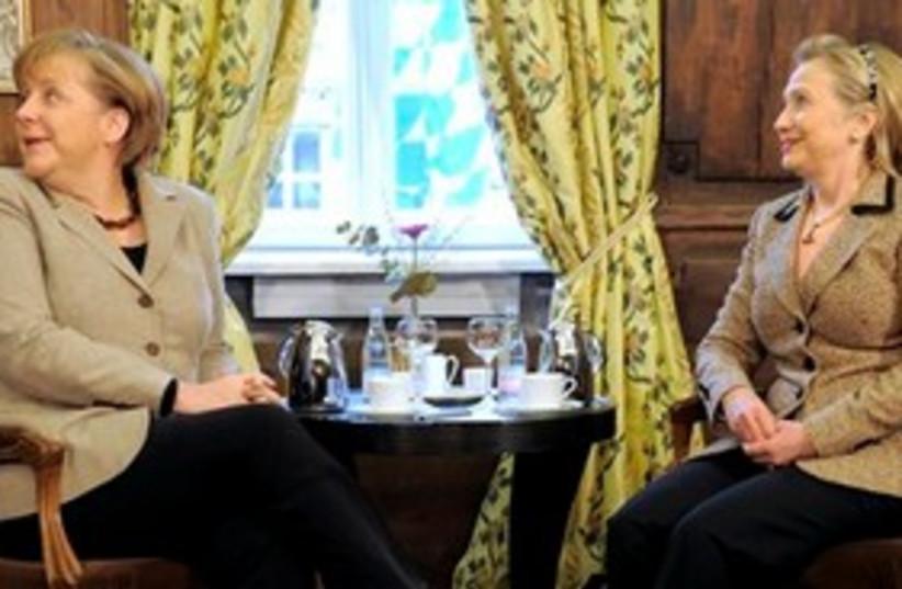 Clinton Merkel 311 (photo credit: Associated Press)