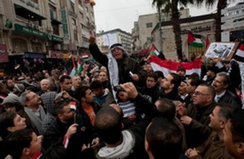 Anti-Mubarak protests in Ramallah (photo credit: AP)