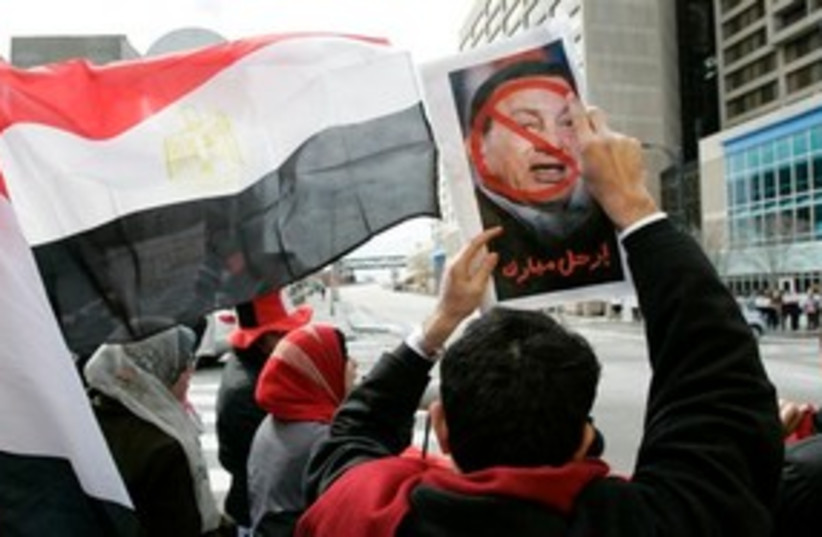Mubarak crossed out 311 (photo credit: Associated Press)