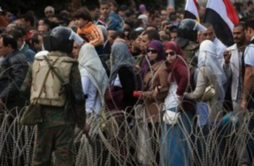 Protesters in Tahrir Square barbed wire 311 AP (photo credit: AP)