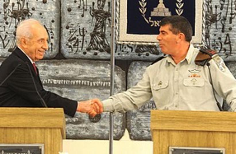 Ashkenazi Peres shaking hands 311 (photo credit: Beit Hanassi)