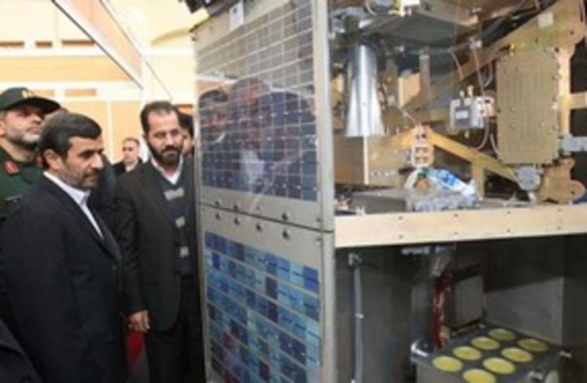 Ahmadinejad with satellites 311 AP (photo credit: AP)