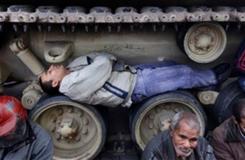 Egyptian man sleeps in tank tracks 311 AP (photo credit: AP)