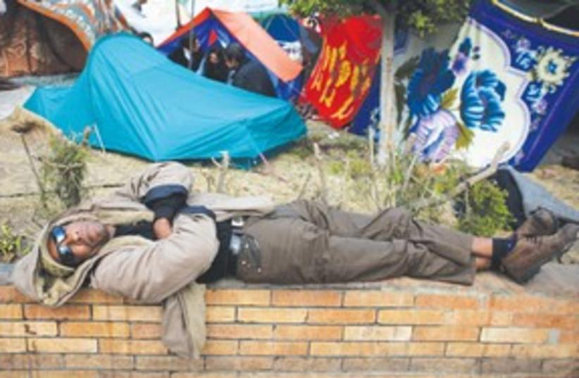 Egypt Protester Sleeps 311 (photo credit: Associated Press)