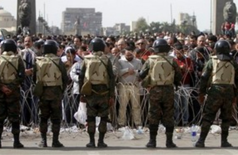 Egyptian troops and protesters in Tahrir Square 311 AP (photo credit: AP)