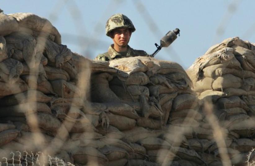 Egyptian border policeman (photo credit: Associated Press)