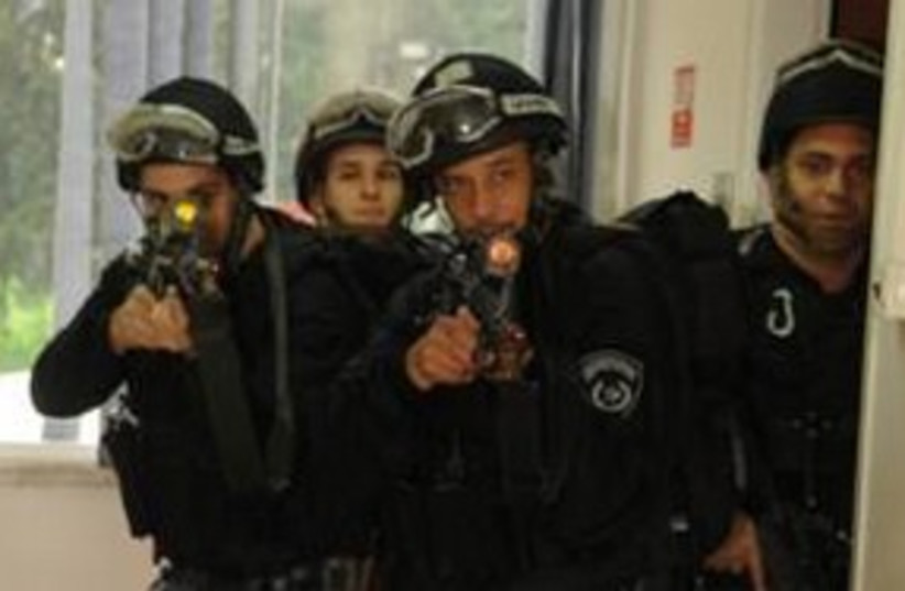 Police drill guns raid cops 311 (photo credit: Israel Police)