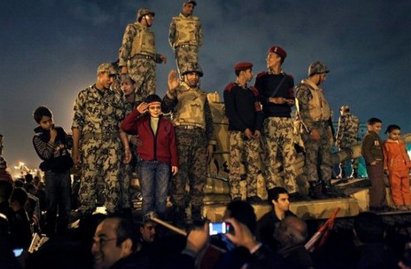 Egyptian soldiers celebrate with children
