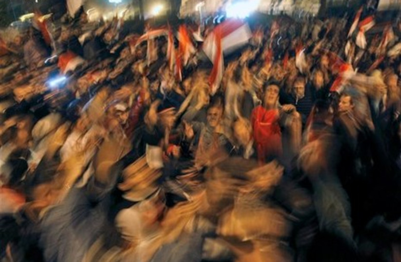 Egyptians dancing in Tahrir Square