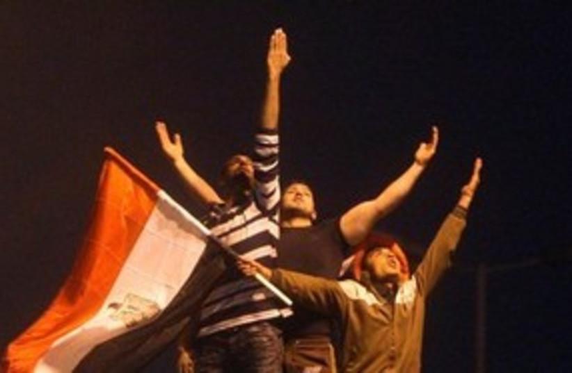 Celebrations  pose Tahrir Square Egypt 311 AP (photo credit: AP)
