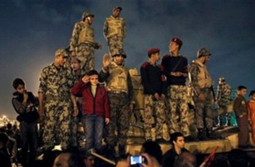Egyptian soldiers celebrate in Tahrir Square 311 AP (photo credit: AP)