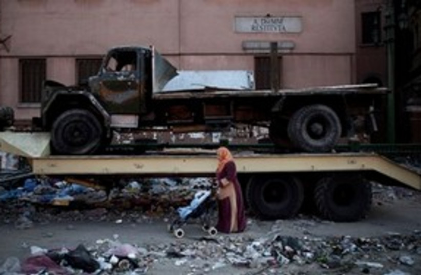 Egyptian woman and baby 311 (photo credit: ASSOCIATED PRESS)