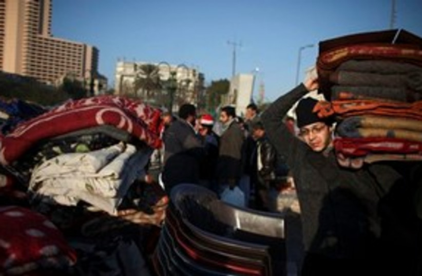 Egyptian returns blankets 311 (photo credit: ASSOCIATED PRESS)