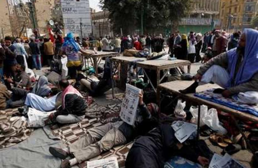 Egyptian anti-government demonstrators rest