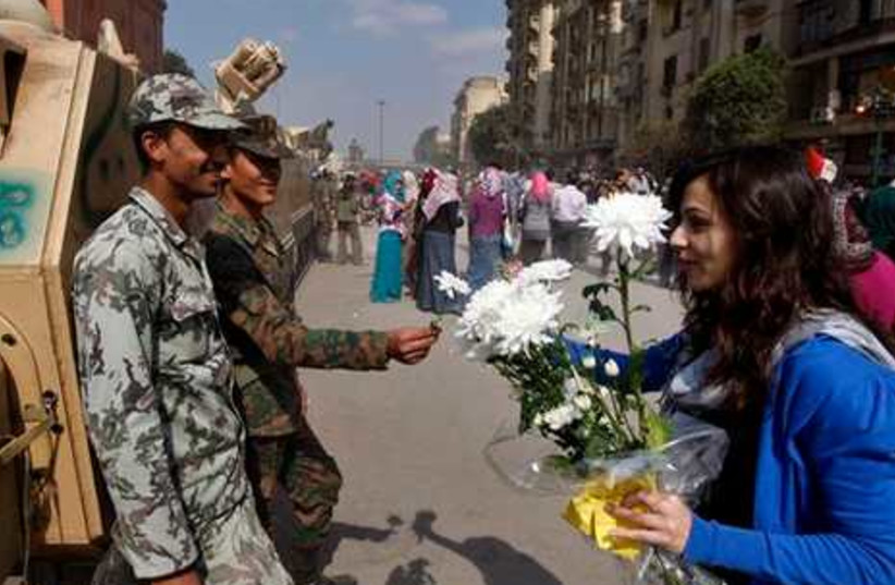 An Egyptian woman presents white flowers