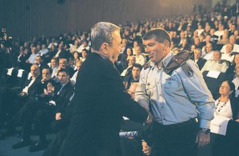 Ashkenazi and Barak farewell 311 (photo credit: Amos Ben-Gershom/GPO)