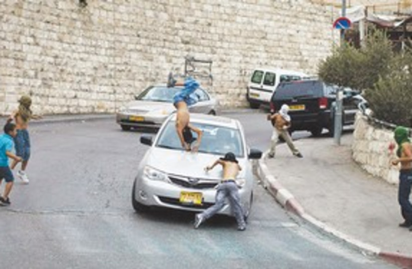 Silwan car crash 311 (photo credit: Ilia Yefimovich/AFP)