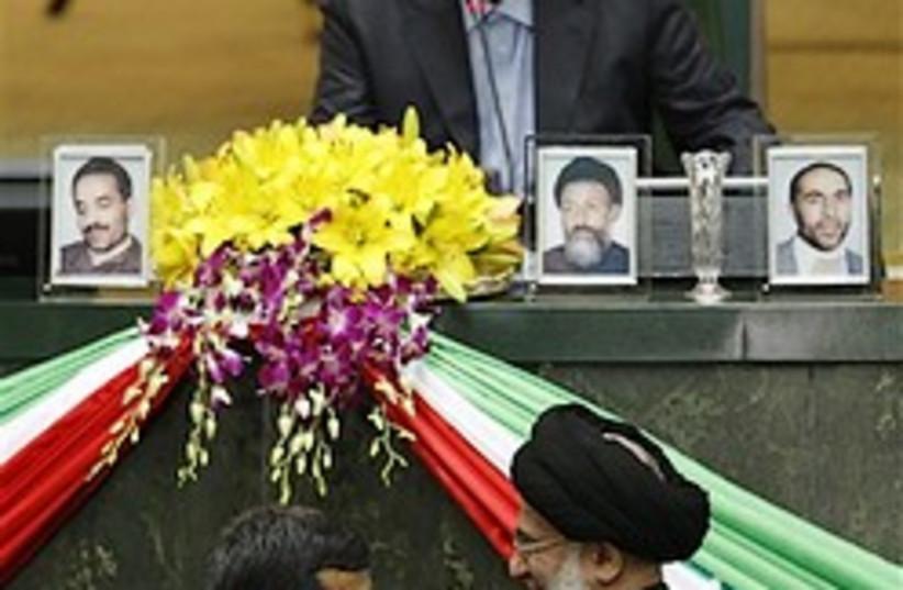Iranian President Mahmoud Ahmadinejad, bottom left (photo credit: AP)