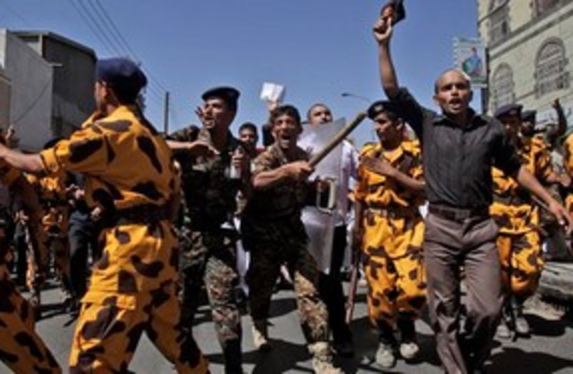 yemen protests 311 (photo credit: AP Photo/Muhammed Muheisen)