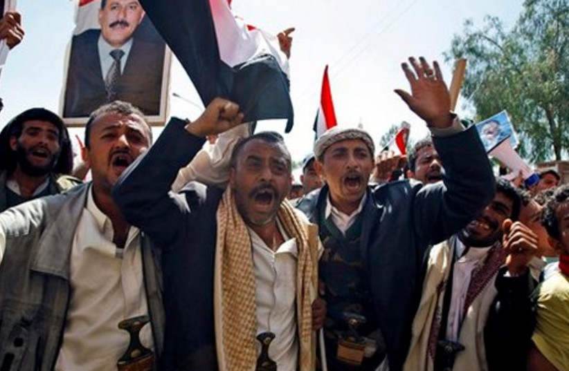 Supporters of Saleh shout slogans