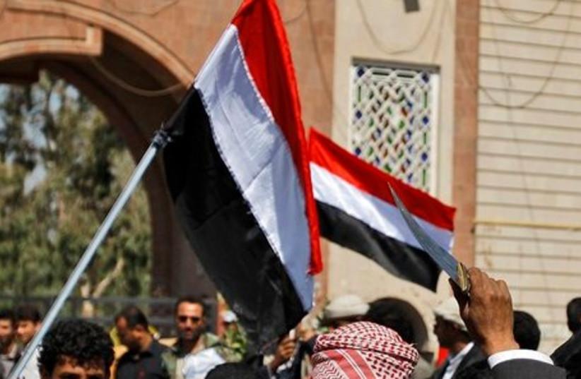 Yemeni pro-gov't protester weilds dagger