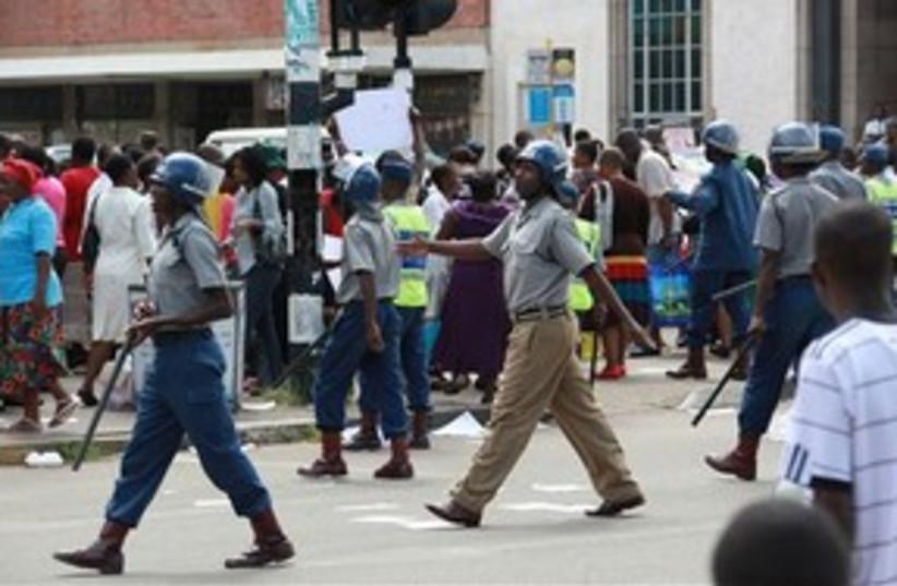 Zimbabwe riot police 311 AP (photo credit: AP)