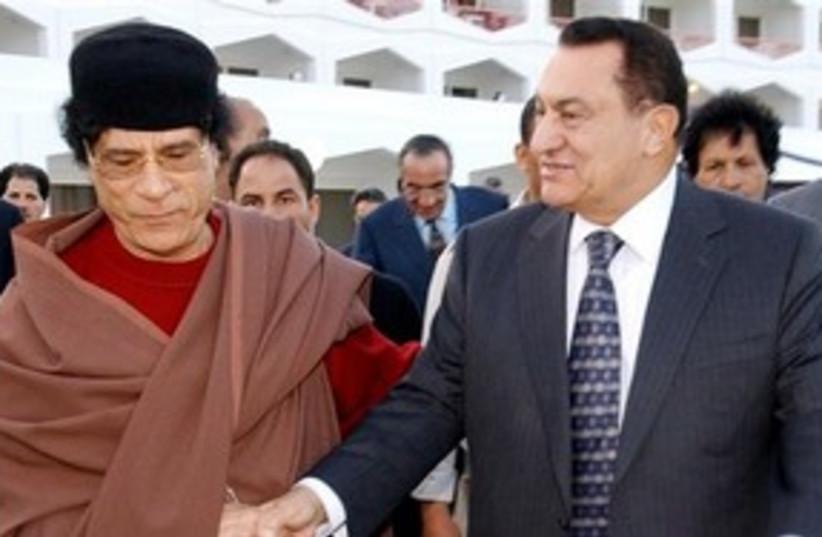 Libyan leader Muammar Gaddafi with Mubarak 311 AP (photo credit: AP)