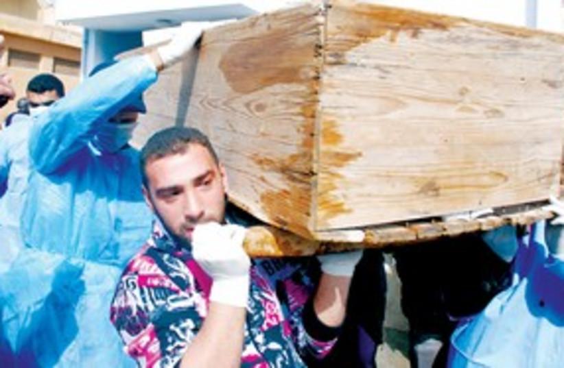 Men carry coffin Libya 311 (photo credit: ASSOCIATED PRESS)