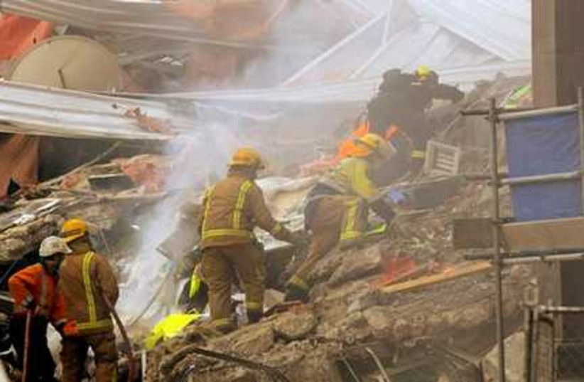 Rescue workers sift through the debris
